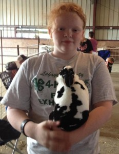 Savannah with her Champion rabbit, Lady, at the Lafayette County 4-H Fair in 2013